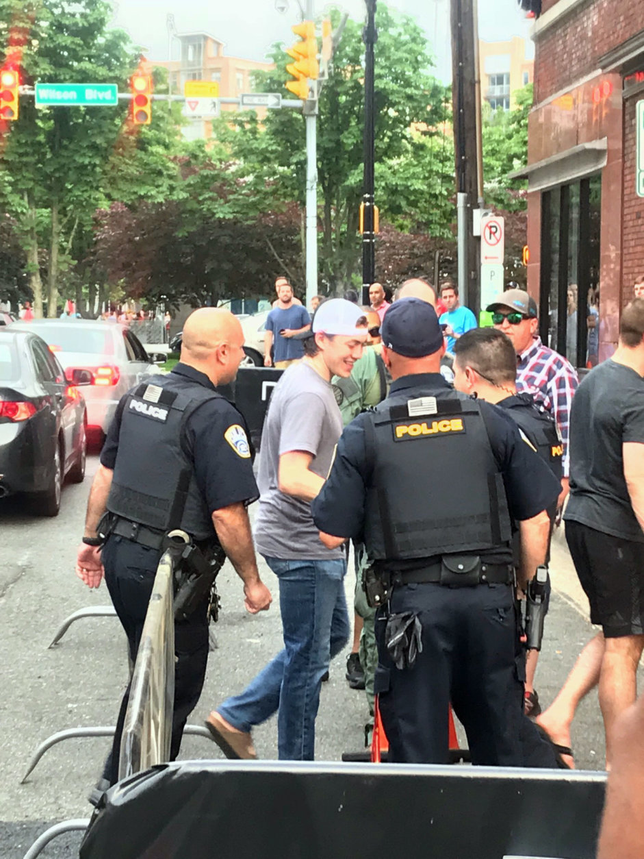 TJ Oshie greets law enforcement outside Don Tito in Clarendon. (WTOP/Chris Cichon)