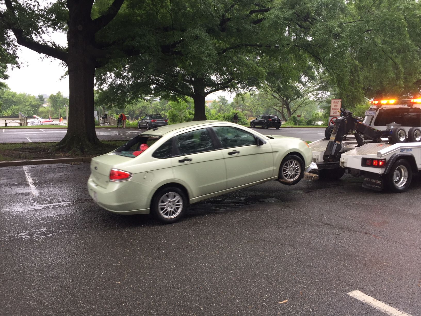 The car was completely submerged and the man was pulled through the car window, according to the Arlington County Fire Department. (WTOP/John Domen)