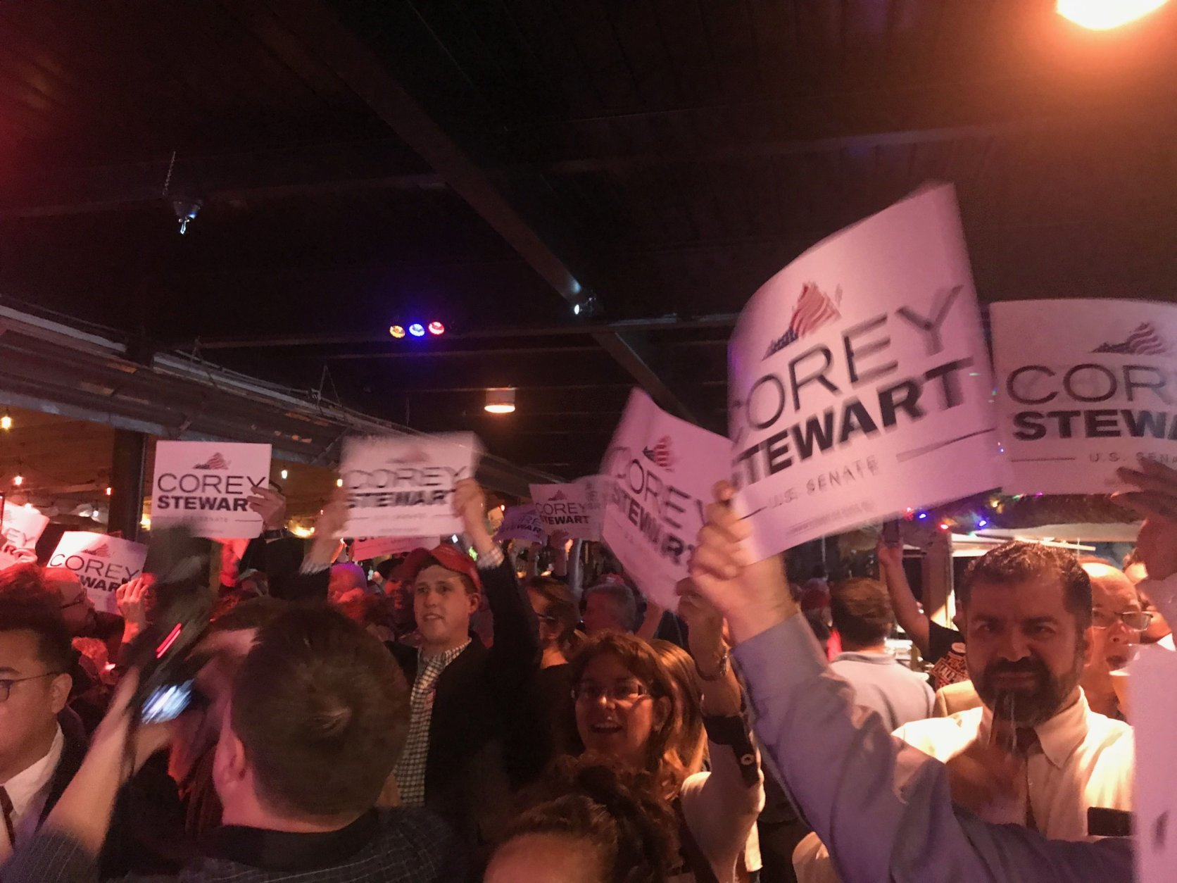 Supporters of Prince William County Board of Supervisors Chairman Corey Stewart cheer his victory in the Republican primary for U.S. Senate June 12, 2018. (WTOP/Dick Uliano)