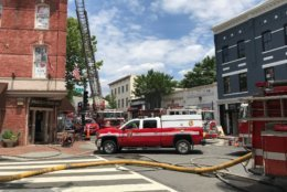 Firetrucks blocked Wisconsin Avenue temporarily while DC Fire and EMS extinguished the flames. (Courtesy Kent Barnes)