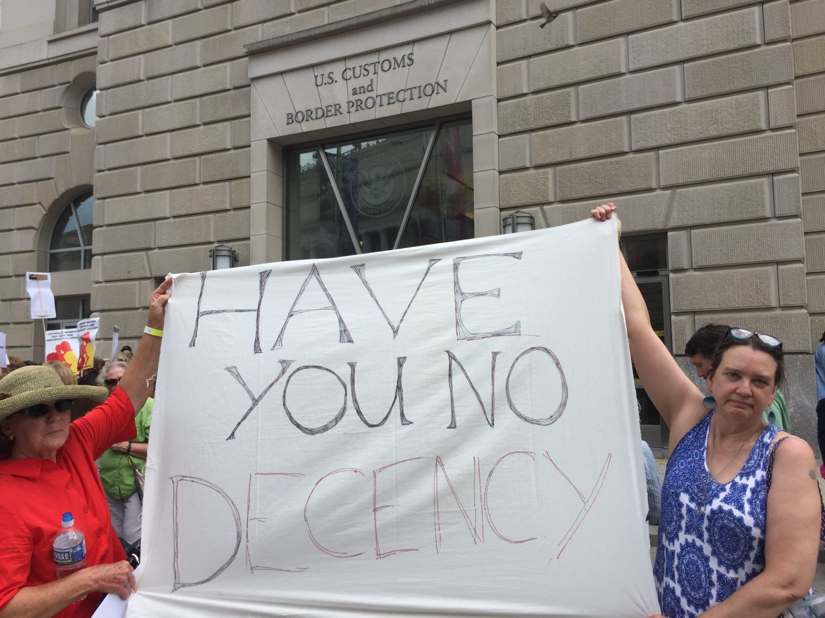 Close to 200 women gathered outside of the United States Customs and Border Protection headquarters in D.C. on Tuesday to protest Trump's immigration policy. (Photo by Don Squires)