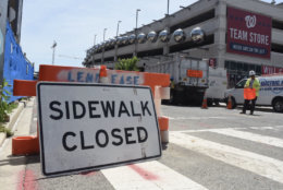 Many sidewalks around Nationals Park are closed or constricted by ongoing construction along Half Street SE and N Street SE. (WTOP/Dave Dildine)