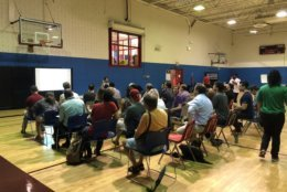 The District Department of Transportation met with community members in the 14th Street corridor Saturday to discuss traffic decongestion and potential bus route improvements. (WTOP/Melissa Howell)