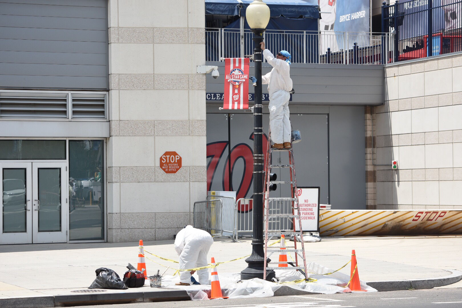 District Department of Transportation crews were seen Monday touching up the lamp posts outside Nationals Park. (WTOP/Dave Dildine)