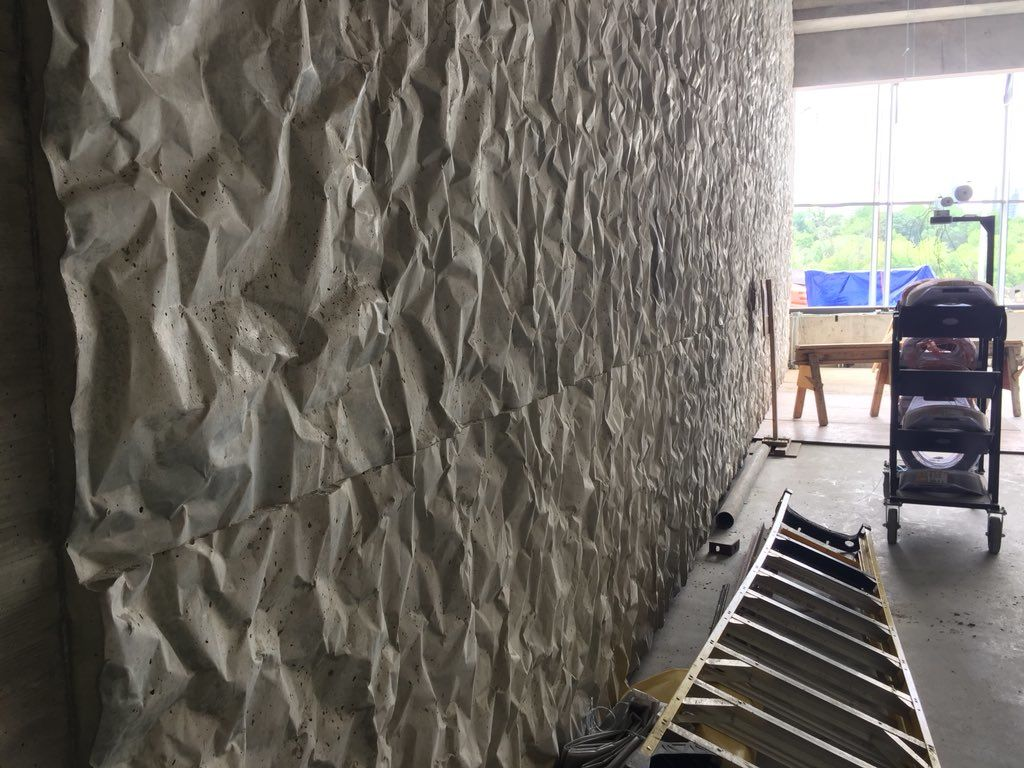 """Crinkle concrete"" is acoustical concrete that was created for the REACH expansion. It allows for performance space walls that double as support walls. There's only one column in the entire structure, and it's a light fixture. (WTOP/Kristi King)"