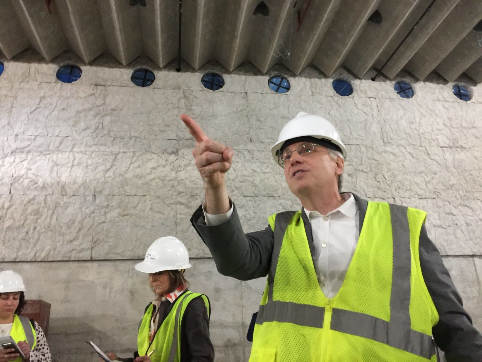 The REACH expansion will be warmed/cooled by water flowing through tubes in the concrete, said architect Chris McVoy. Also note that the ceiling has acoustic 'ribs.' (WTOP/Kristi King)