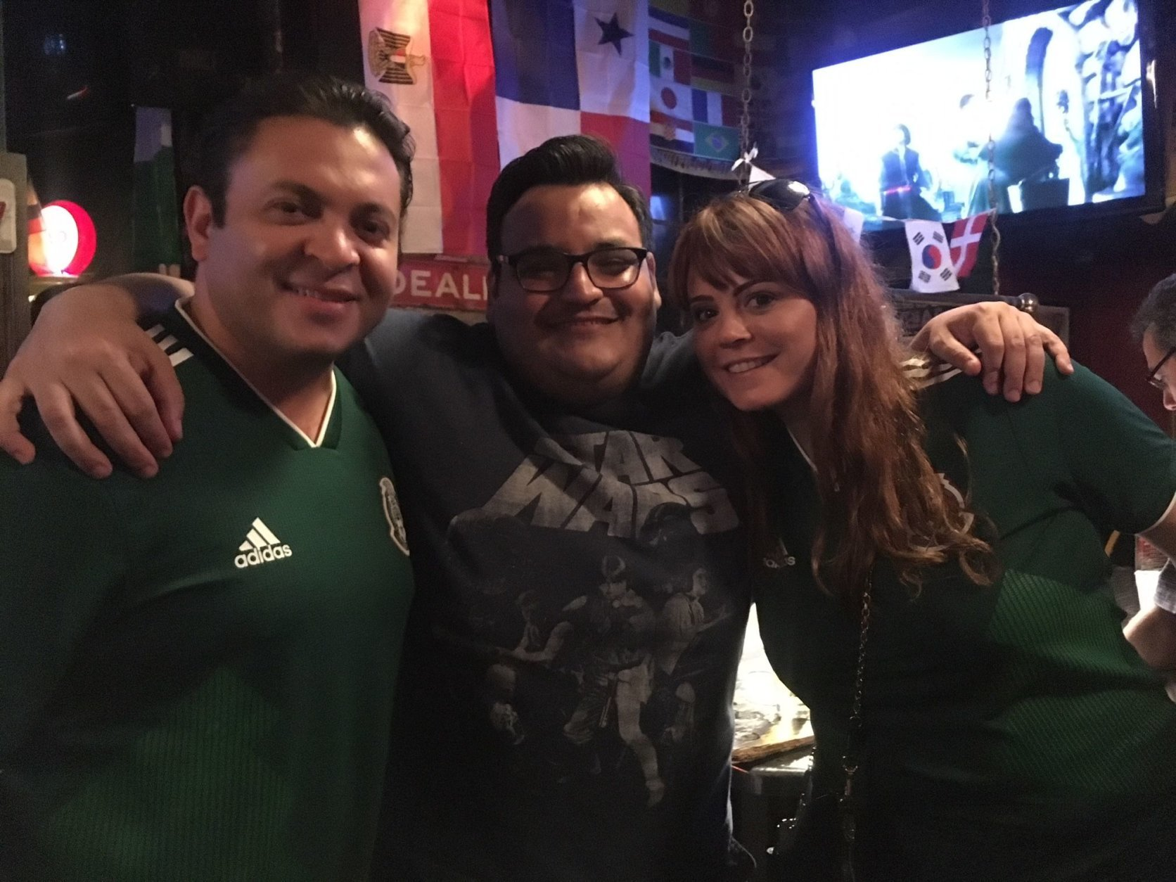 "Omar Valdez (left) is Mexican-born, while friend Burt Lopez and girlfriend Rachel Gottesfeld are ""adopted Mexican,"" he says. ""We're world citizens."" (WTOP/Noah Frank)"