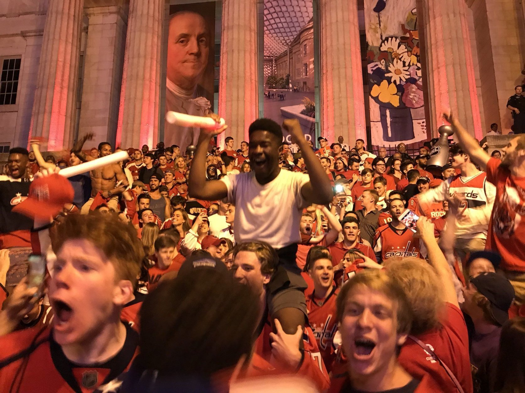 After the Caps beat the Golden Knights 6-2 in Game 4, Caps fans outside the Capital One Arena in Washington, D.C. celebrated in earnest on Monday, June 4, 2018. (WTOP/Michelle Basch)