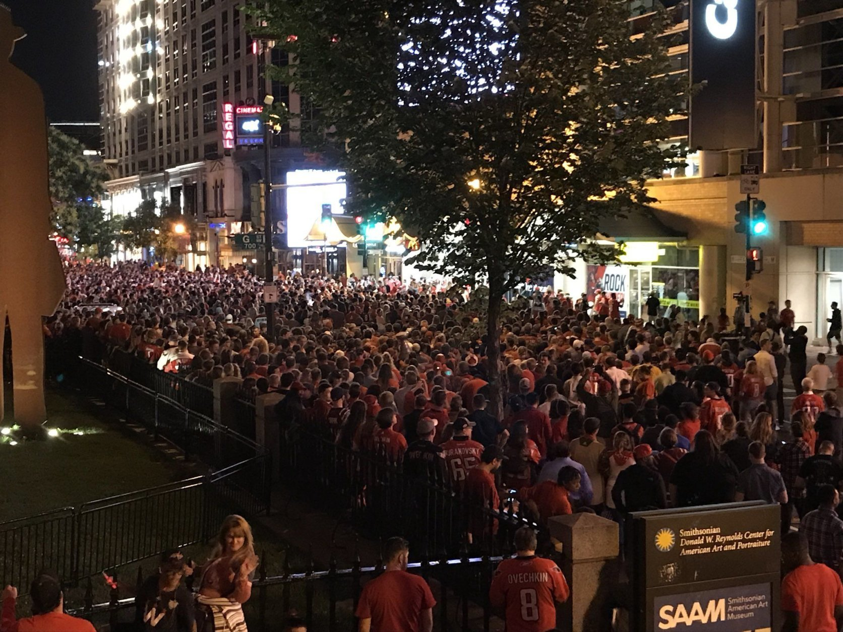 Fans of the Washington Capitals follow the Game 4 matchup outside the Capital One Arena in Washington, D.C. on Monday, June 4, 2018. (WTOP/Michelle Basch)