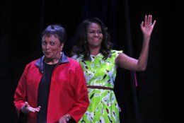 Former first lady Michelle Obama waves as she arrives with Librarian of Congress Dr. Carla Hayden, left, to speak at the American Library Association annual conference in New Orleans, Friday, June 22, 2018. (AP Photo/Gerald Herbert)