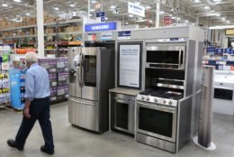 "FILE- In this May 21, 2018, file photo, kitchen appliances for sale at at Lowe's Home Improvement store in East Rutherford, N.J. Home improvements can rejuvenate a stale dwelling. You don't have to revamp every inch of a room. Dan DiClerico, a home expert at HomeAdvisor.suggests that you ""splurge on the things you're interacting with on a daily basis."" (AP Photo/Ted Shaffrey, File)"