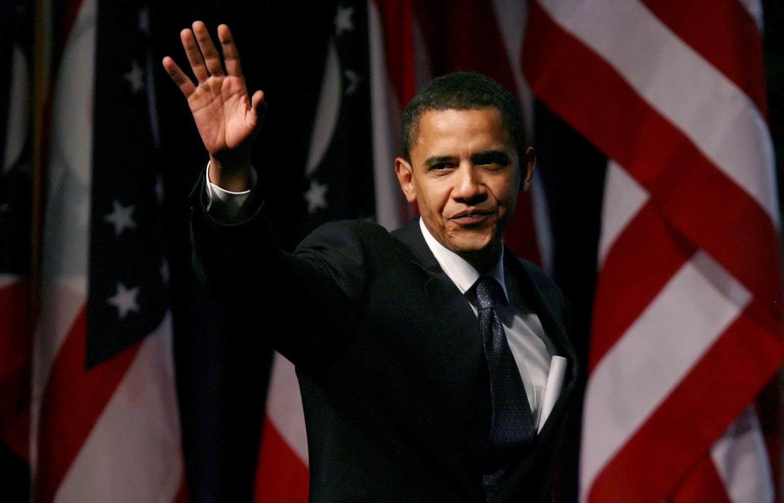 U.S. Sen. Barack Obama, D-Ill, takes the stage to speak at the Ohio Democratic Party State Dinner in Columbus, Ohio, Saturday, June 3, 2006. (AP Photo/Will Shilling)