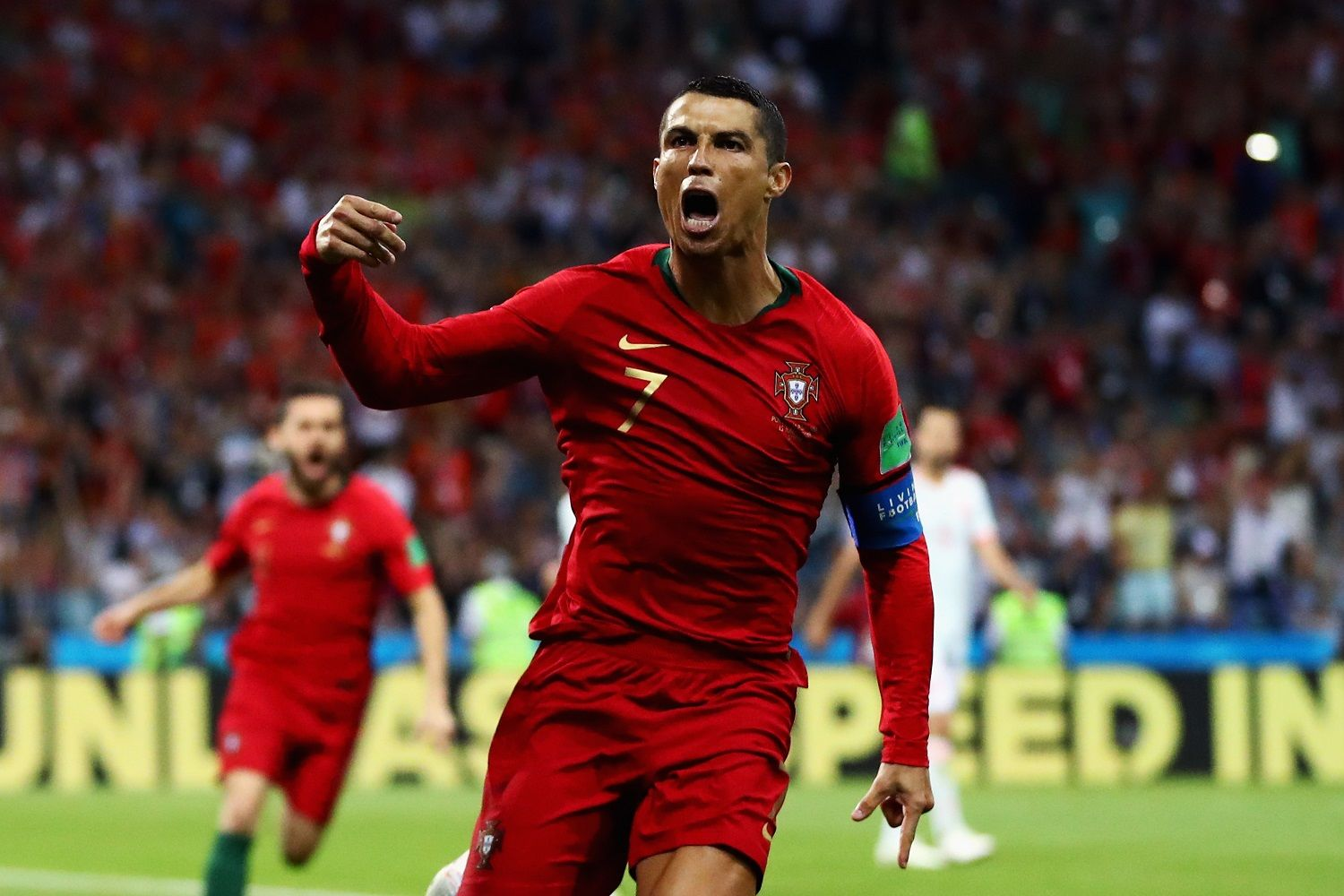 SOCHI, RUSSIA - JUNE 15:  Cristiano Ronaldo of Portugal celebrates after scoring his team's first goal during the 2018 FIFA World Cup Russia group B match between Portugal and Spain at Fisht Stadium on June 15, 2018 in Sochi, Russia.  (Photo by Dean Mouhtaropoulos/Getty Images)