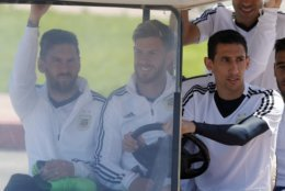 From left to right, Lionel Messi, Cristian Ansaldi and Angel Di Maria arrive for a training session of Argentina on the eve of their group D match against Iceland at the 2018 soccer World Cup in Bronnitsy, Russia, Friday, June 15, 2018. (AP Photo/Ricardo Mazalan)