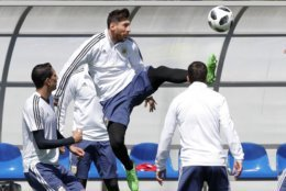 Lionel Messi plays the ball during a training session of Argentina on the eve of the group D match against Iceland at the 2018 soccer World Cup in Bronnitsy, Russia, Friday, June 15, 2018. (AP Photo/Ricardo Mazalan)