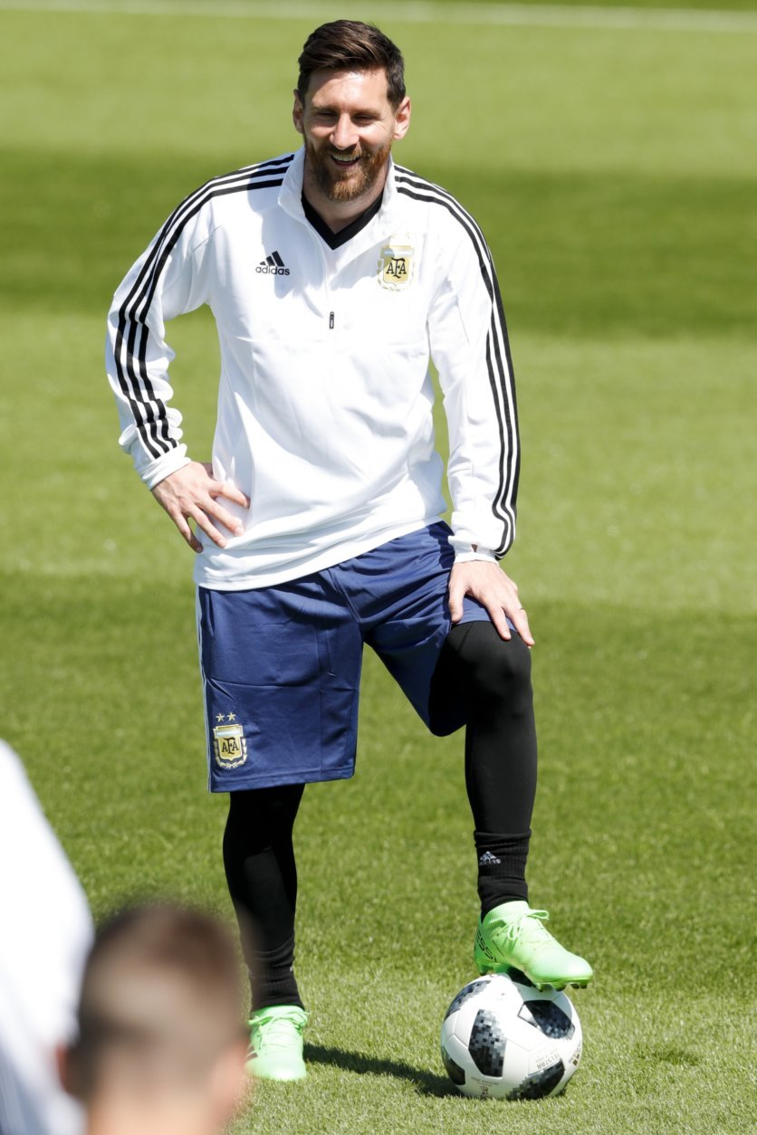 Lionel Messi smiles during a training session of Argentina on the eve of the group D match against Iceland at the 2018 soccer World Cup in Bronnitsy, Russia, Friday, June 15, 2018. (AP Photo/Ricardo Mazalan)