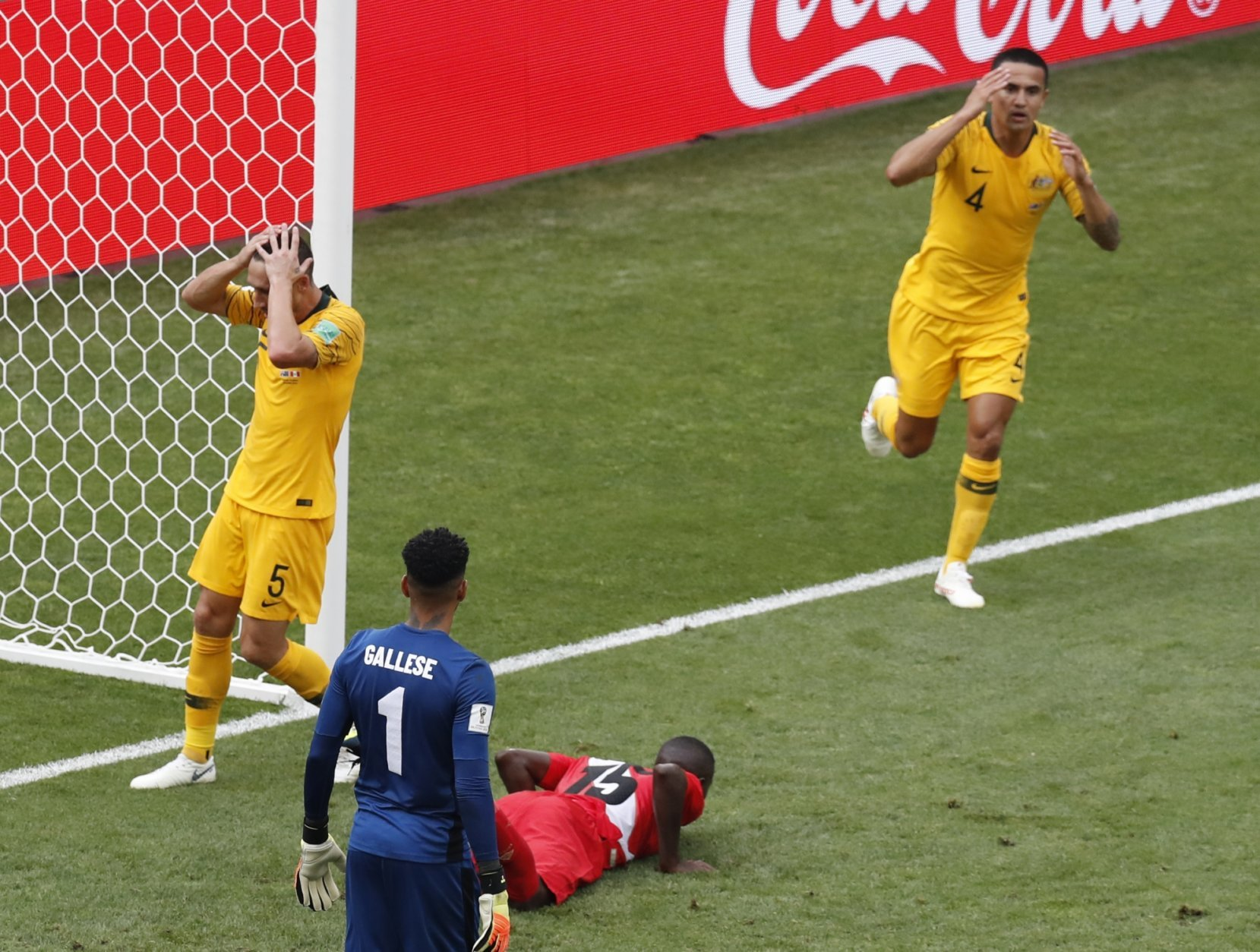 Australia's Mark Milligan, left, and Australia's Tim Cahill, right, react after missing a chance to score during the group C match between Australia and Peru, at the 2018 soccer World Cup in the Fisht Stadium in Sochi, Russia, Tuesday, June 26, 2018. (AP Photo/Efrem Lukatsky)
