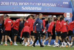Denmark coach Age Hareide, center, walks on the pitch during his team official training on the eve of the group C match between Peru and Denmark at the 2018 soccer World Cup in the Mordovia Arena in Saransk, Russia, Friday, June 15, 2018. (AP Photo/Gregorio Borgia)