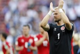 Denmark goalkeeper Kasper Schmeichel applauds to supporters after the group C match between Denmark and France at the 2018 soccer World Cup at the Luzhniki Stadium in Moscow, Russia, Tuesday, June 26, 2018. (AP Photo/David Vincent)