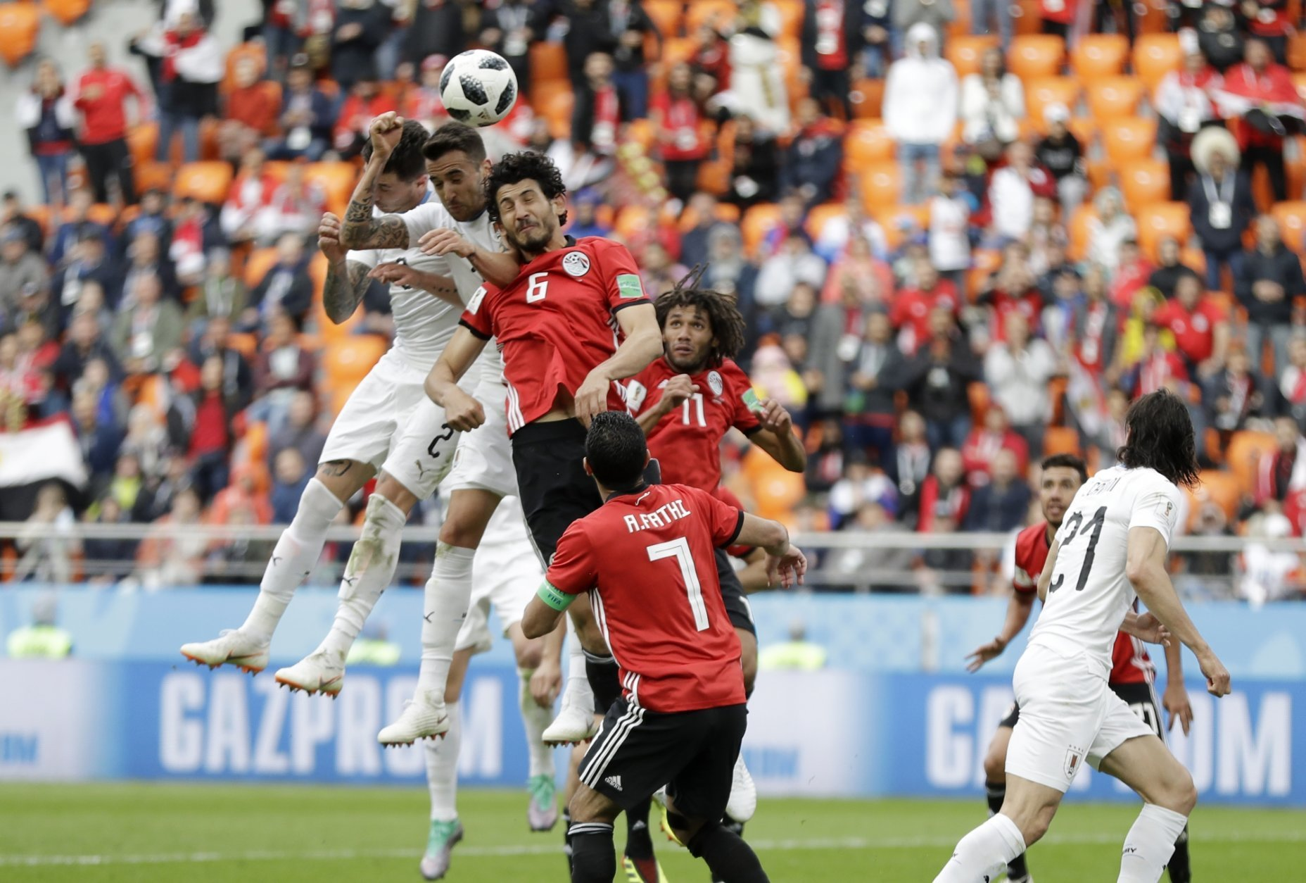 Uruguay's Jose Gimenez, second from top left, scores his side's opening goal during the group A match between Egypt and Uruguay at the 2018 soccer World Cup in the Yekaterinburg Arena in Yekaterinburg, Russia, Friday, June 15, 2018. (AP Photo/Natacha Pisarenko)