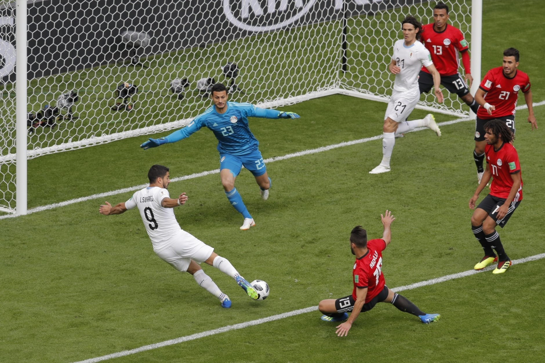 Uruguay's Luis Suarez, left, scores a disallowed goal during the group A match between Egypt and Uruguay at the 2018 soccer World Cup in the Yekaterinburg Arena in Yekaterinburg, Russia, Friday, June 15, 2018. (AP Photo/Vadim Ghirda)