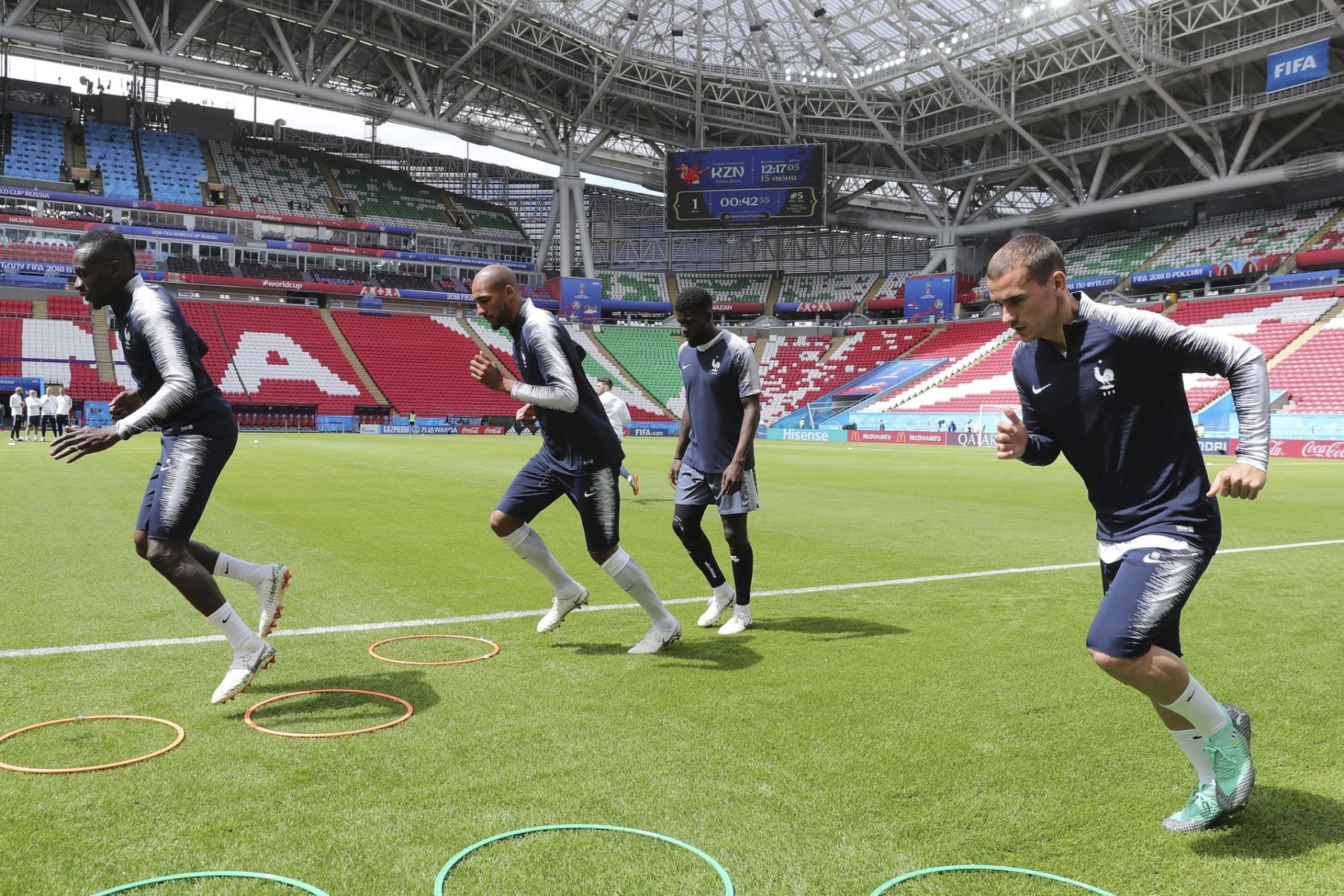 France's Antoine Griezmann, rear right, run on the field during France's official training on the eve of the group C match between France and Australia at the 2018 soccer World Cup in the Kazan Arena in Kazan, Russia, Friday, June 15, 2018. (AP Photo/David Vincent)