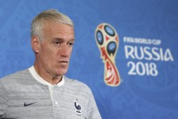 France headcoach Didier Deschamps arrives at the France's official press conference on the eve of the group C match between France and Australia at the 2018 soccer World Cup in the Kazan Arena in Kazan, Russia, Friday, June 15, 2018. (AP Photo/David Vincent)