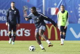France's Paul Pogba controls the ball during the first training session of France at the 2018 soccer World Cup in Glebovets, Russia, Monday, June 11, 2018. (AP Photo/David Vincent)