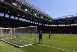 Iceland goalkeeper Runar Runarsson, left, catches a ball during Iceland's official training on the eve of the group D match between Argentina and Iceland at the 2018 soccer World Cup in the Spartak Stadium in Moscow, Russia, Friday, June 15, 2018. (AP Photo/Eduardo Verdugo)