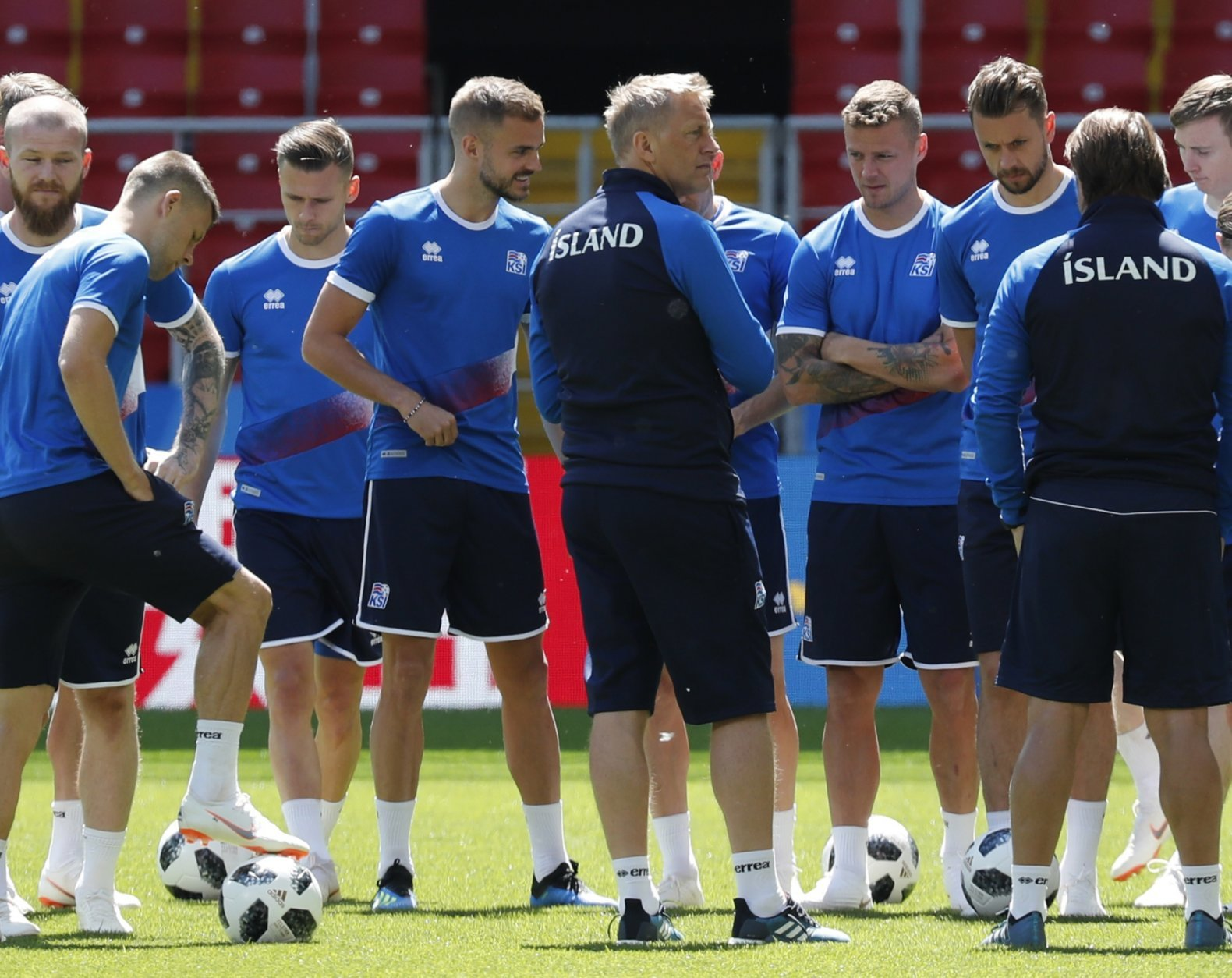Iceland coach Heimar Hallgrimsson, center, talks with his players at the start of Iceland's official training on the eve of the group D match between Argentina and Iceland at the 2018 soccer World Cup in Spartak Stadium in Moscow, Russia, Friday, June 15, 2018. (AP Photo/Rebecca Blackwell)