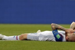Iceland's Aron Gunnarsson lies on the pitch at the end of the group D match between Iceland and Croatia, at the 2018 soccer World Cup in the Rostov Arena in Rostov-on-Don, Russia, Tuesday, June 26, 2018. (AP Photo/Vadim Ghirda)