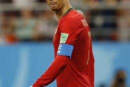 Portugal's Cristiano Ronaldo reacts after failing to score from the penalty spot during the group B match between Iran and Portugal at the 2018 soccer World Cup at the Mordovia Arena in Saransk, Russia, Monday, June 25, 2018. (AP Photo/Francisco Seco)
