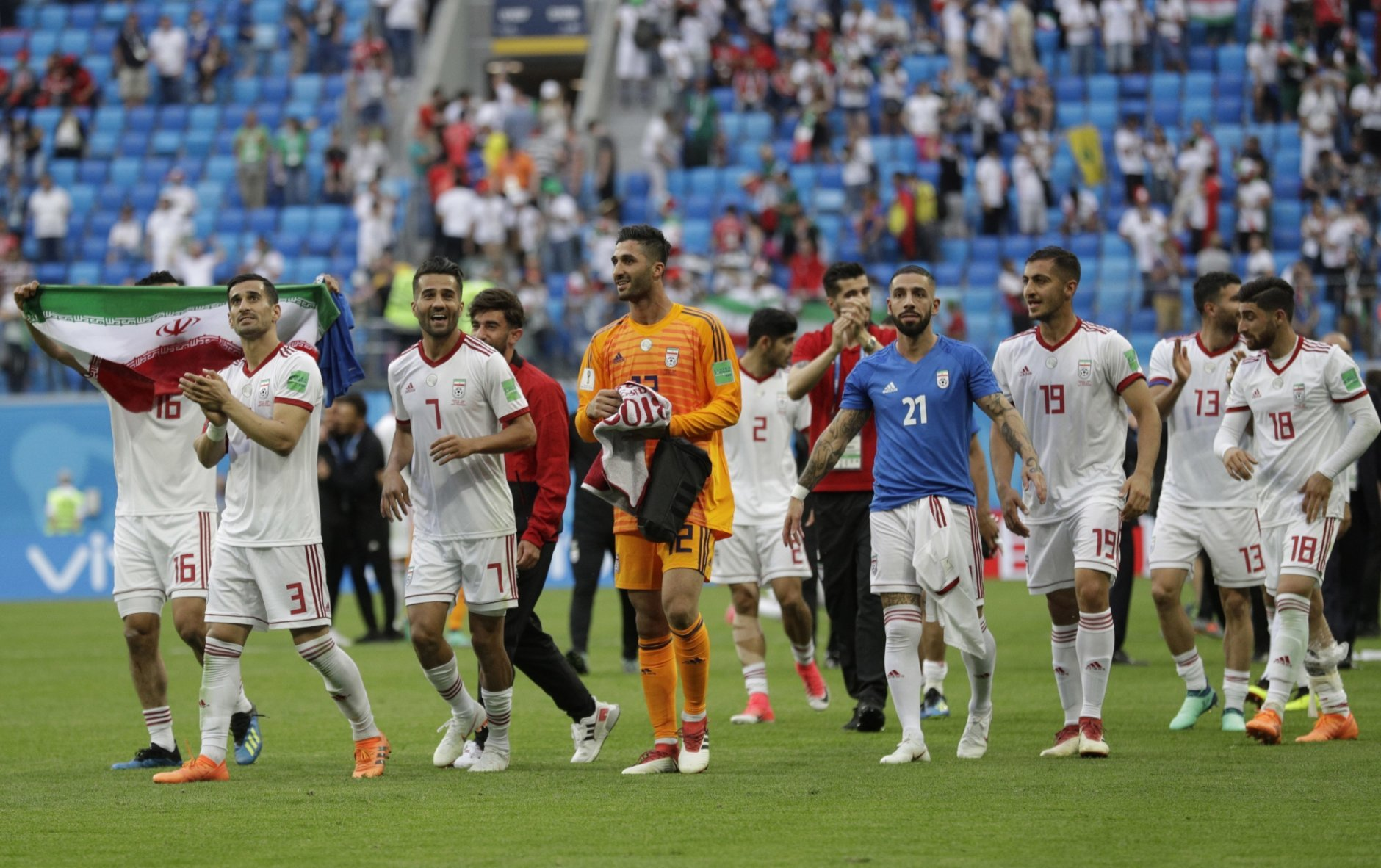 Iran's players celebrate their victory at the group B match between Morocco and Iran at the 2018 soccer World Cup in the St. Petersburg Stadium in St. Petersburg, Russia, Friday, June 15, 2018. (AP Photo/Andrew Medichini)