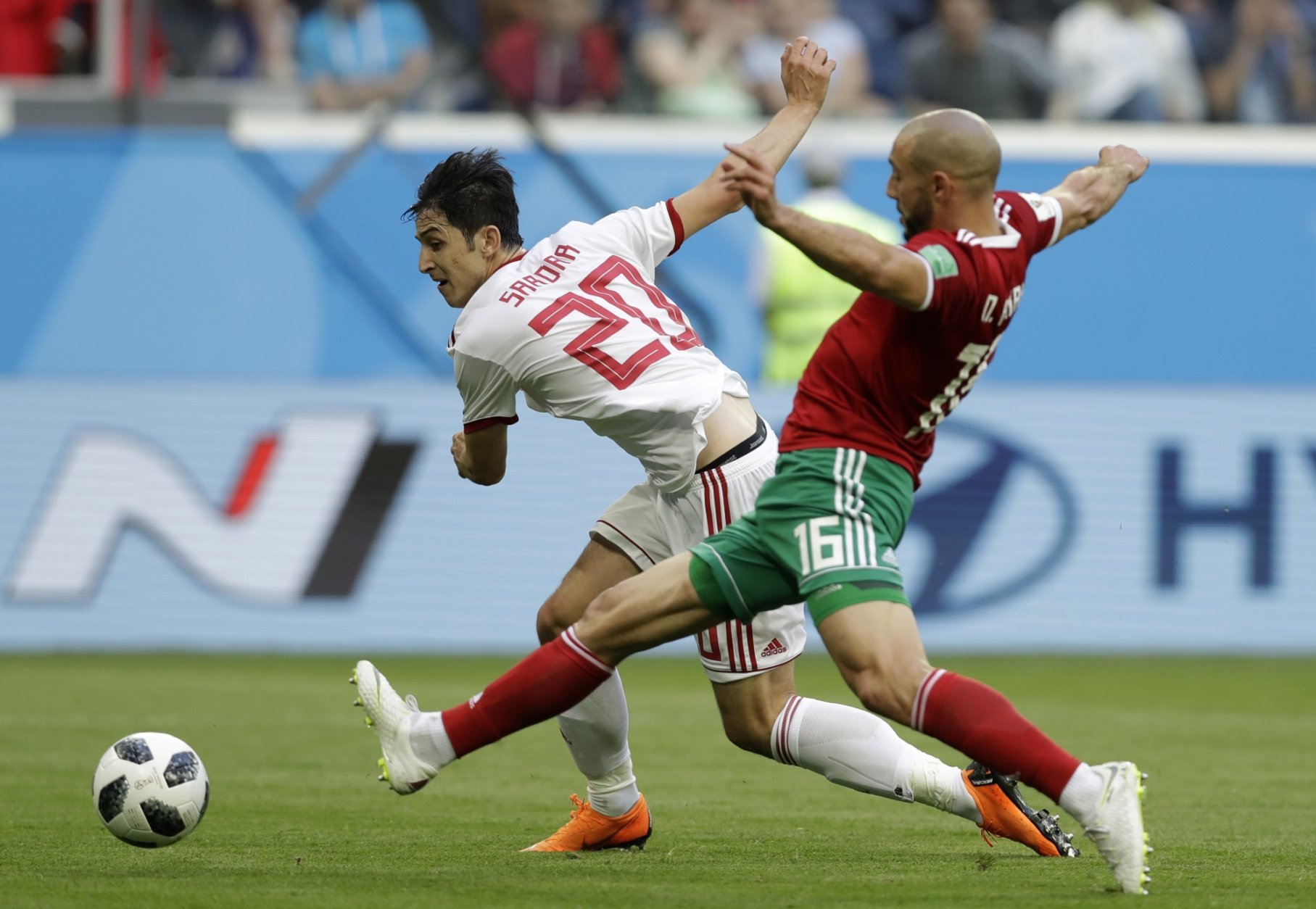 Morocco's Noureddine Amrabat, left, and Iran's Sardar Azmoun compete for the ball during the group B match between Morocco and Iran at the 2018 soccer World Cup in the St. Petersburg Stadium in St. Petersburg, Russia, Friday, June 15, 2018. (AP Photo/Andrew Medichini)