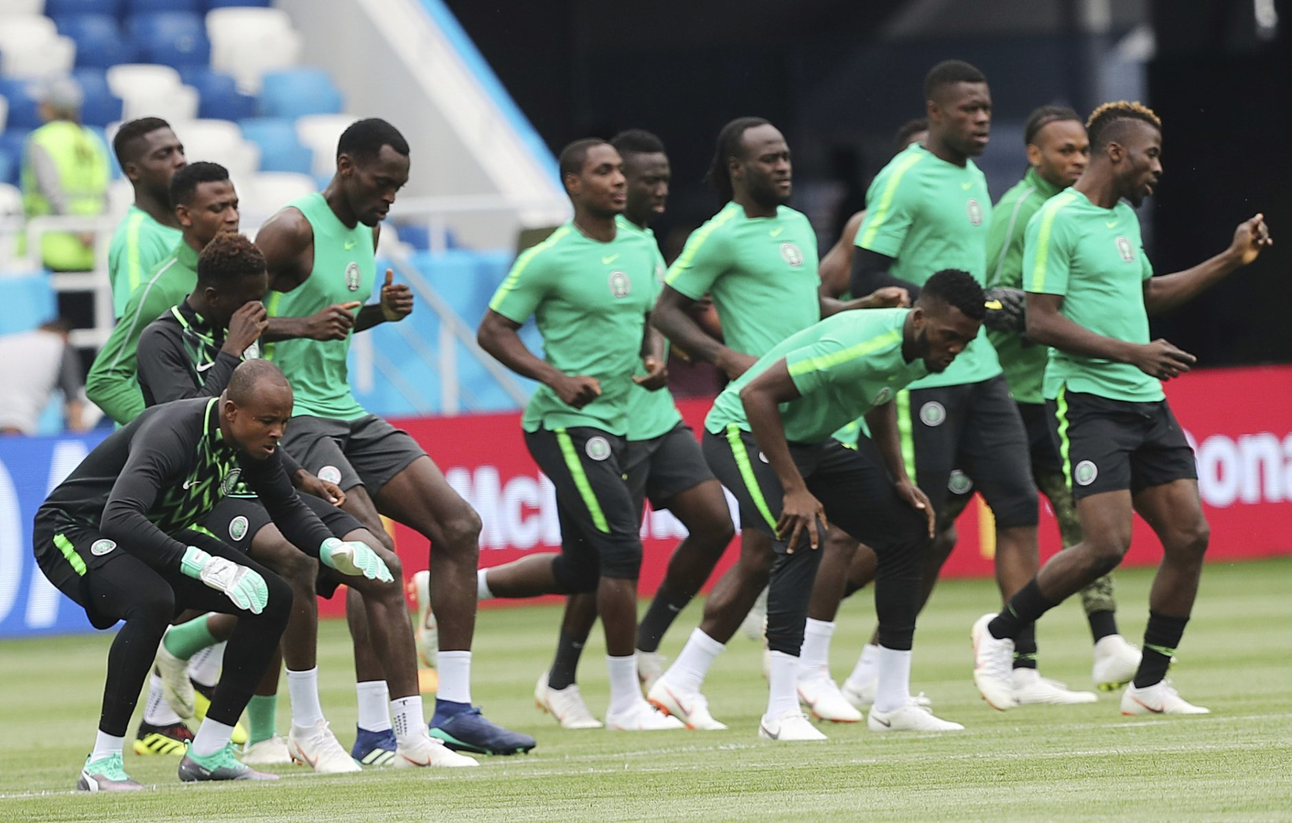 Players warm up during Nigeria's official training on the eve of the group D match between Croatia and Nigeria at the 2018 soccer World Cup in the Kaliningrad Stadium in Kaliningrad, Russia, Friday, June 15, 2018. (AP Photo/Czarek Sokowski)