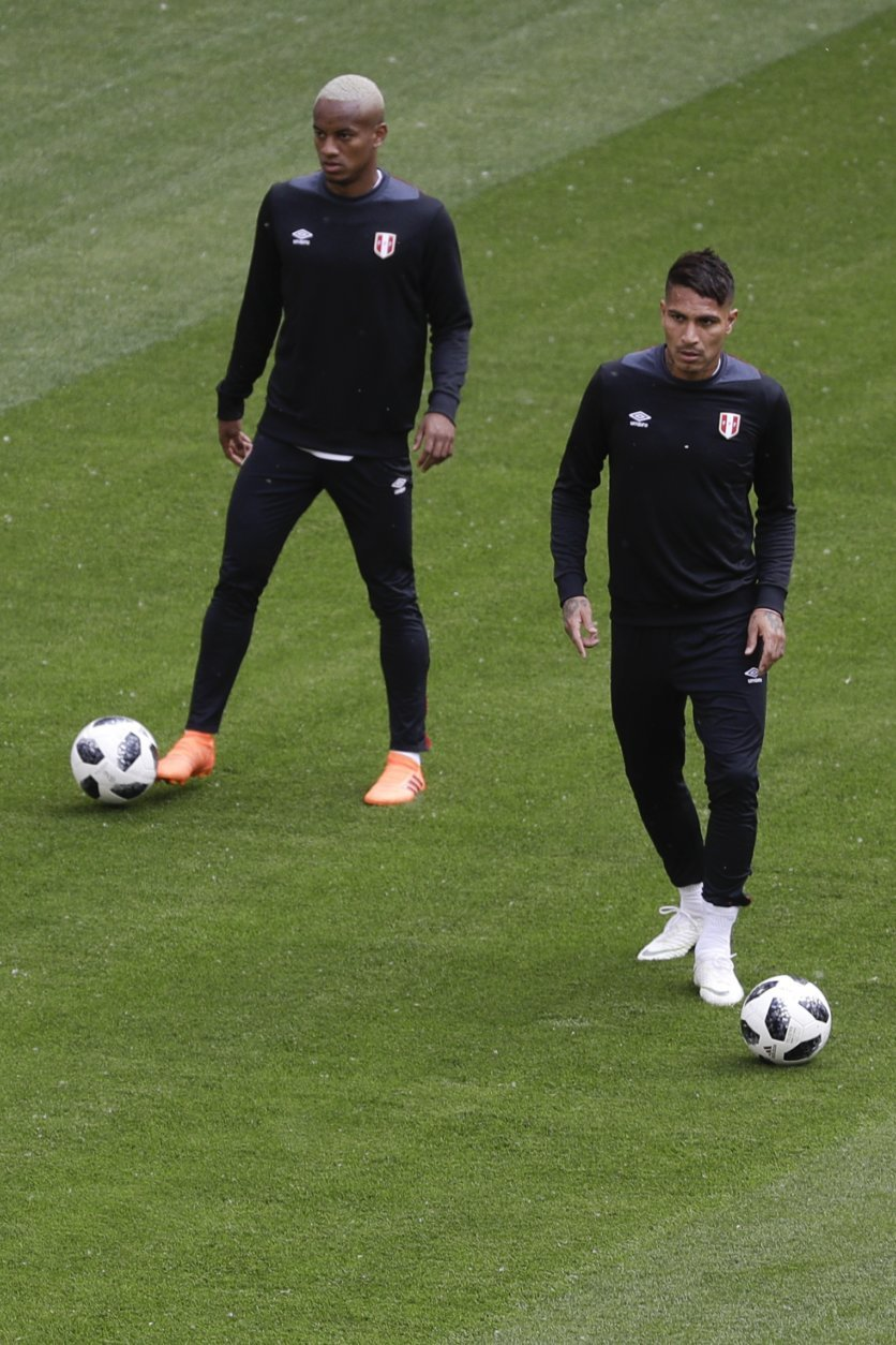 Peru's Paolo Guerrero, right, and teammate Andre Carrillo warm up during Peru's official training on the eve of the group C match between Peru and Denmark at the 2018 soccer World Cup in the Mordovia Arena in Saransk, Russia, Friday, June 15, 2018. (AP Photo/Gregorio Borgia)