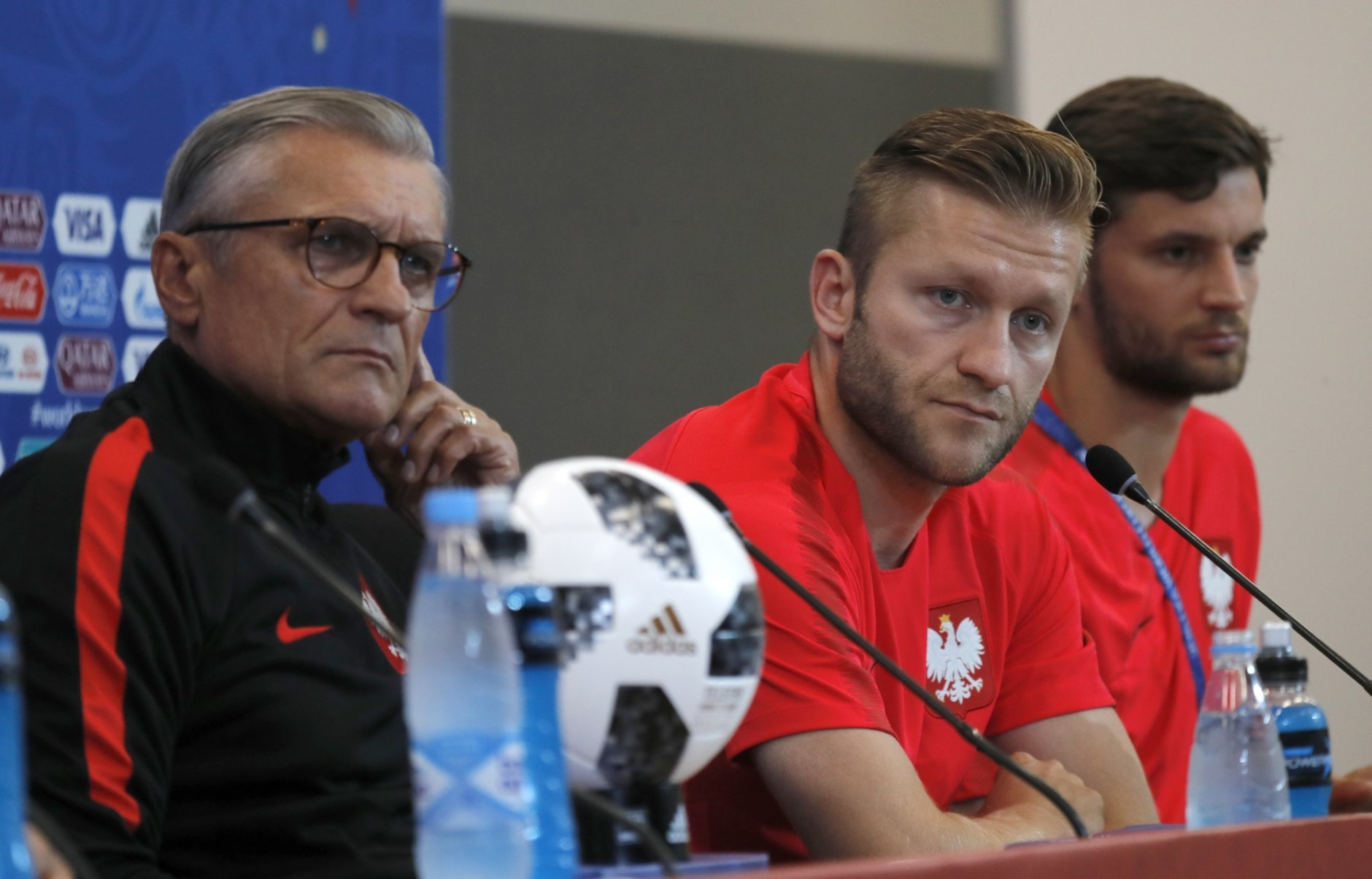 From left, Poland head coach Adam Nawalka, and Poland's Bartosz Bereszynski, attend Poland's official press conference on the eve of the group H match between Poland and Japan at the Volgograd Arena the 2018 soccer World Cup in Volgograd , Russia, Wednesday, June 27, 2018. (AP Photo/Eugene Hoshiko)