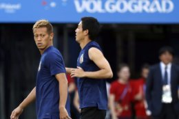 Japan's Keisuke Honda, left, and Japan's Gen Shoji, right, warm up during the Japan's official training on the eve of the group H match between Poland and Japan at the Volgograd Arena the 2018 soccer World Cup in Volgograd, Russia, Wednesday, June 27, 2018. (AP Photo/Eugene Hoshiko)