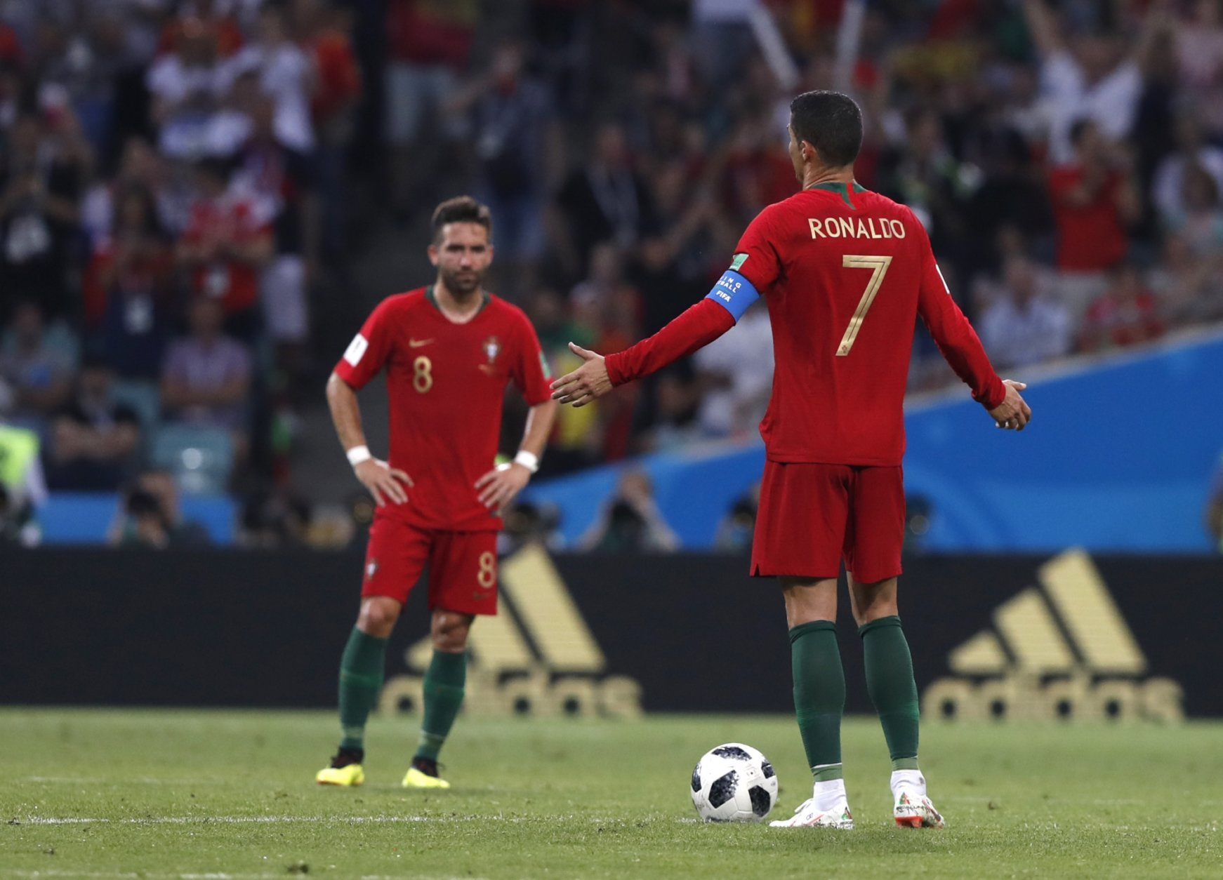 Portugal's Cristiano Ronaldo gestures to his teammates after Spain scored their 3rd goal during the group B match between Portugal and Spain at the 2018 soccer World Cup in the Fisht Stadium in Sochi, Russia, Friday, June 15, 2018. (AP Photo/Manu Fernandez)