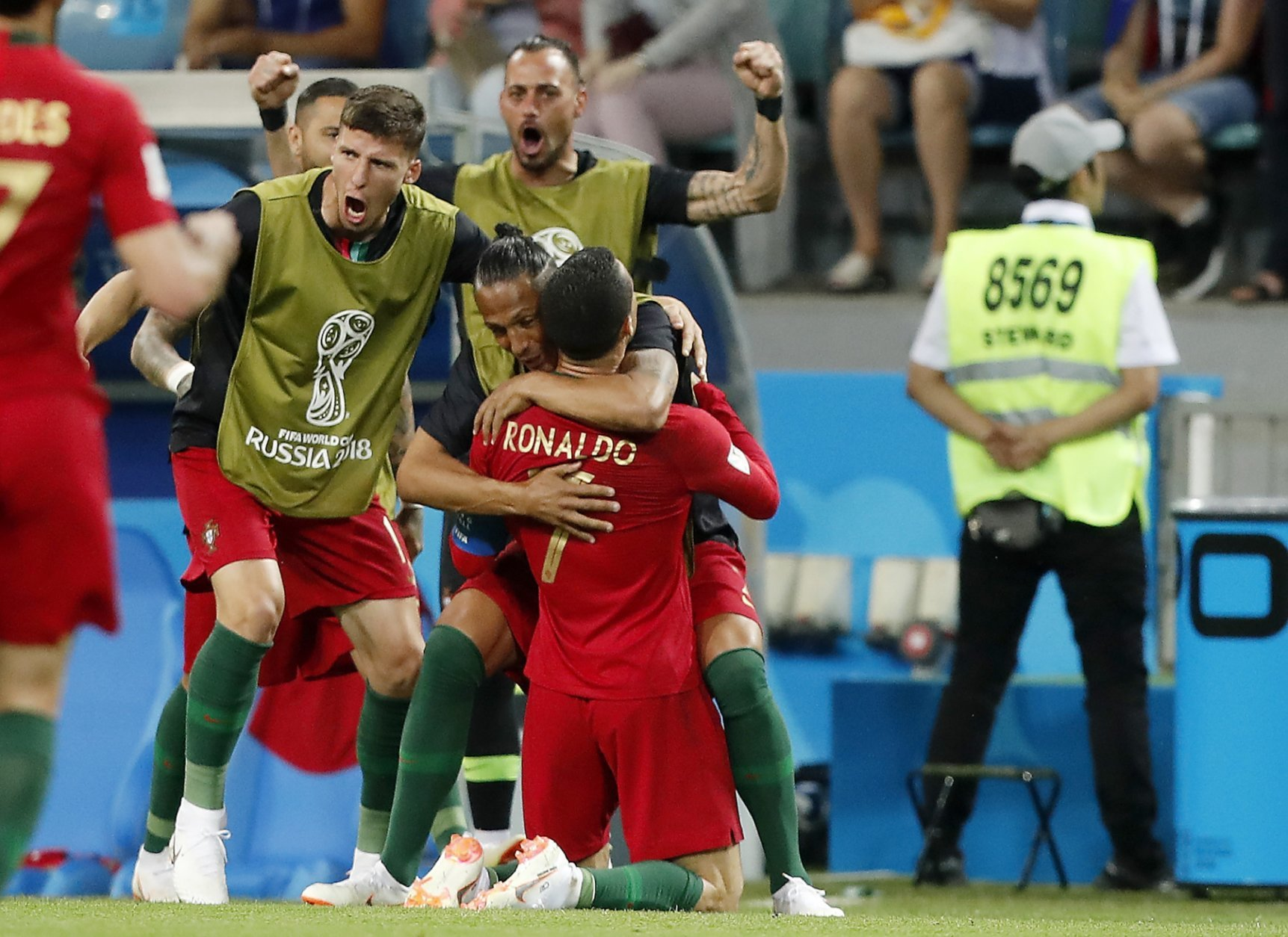 Portugal's Cristiano Ronaldo slides on the ground to his bench after scoring his second goal during the group B match between Portugal and Spain at the 2018 soccer World Cup in the Fisht Stadium in Sochi, Russia, Friday, June 15, 2018. (AP Photo/Frank Augstein)
