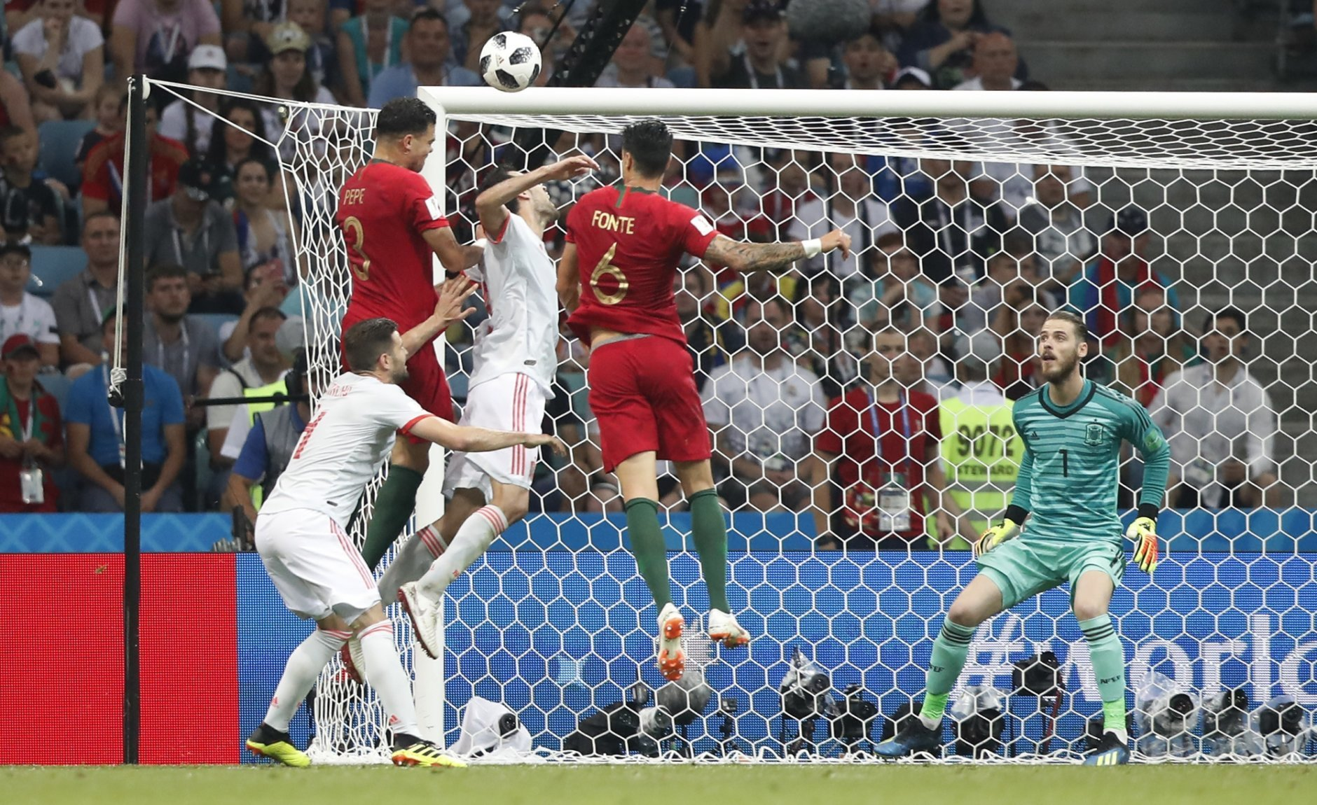 Portugal's Pepe and Portugal's Jose Fonte challenge for the ball in front of Spain goalkeeper David De Gea during the group B match between Portugal and Spain at the 2018 soccer World Cup in the Fisht Stadium in Sochi, Russia, Friday, June 15, 2018. (AP Photo/Frank Augstein)