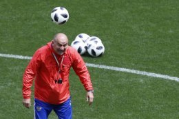 Russia head coach Stanislav Cherchesov controls for the ball during the official training session of the Russian team one the ing eve of the group A match between Russia and Saudi Arabia at the 2018 soccer World Cup at Luzhniki stadium in Moscow, Russia, Wednesday, June 13, 2018. (AP Photo/Hassan Ammar)