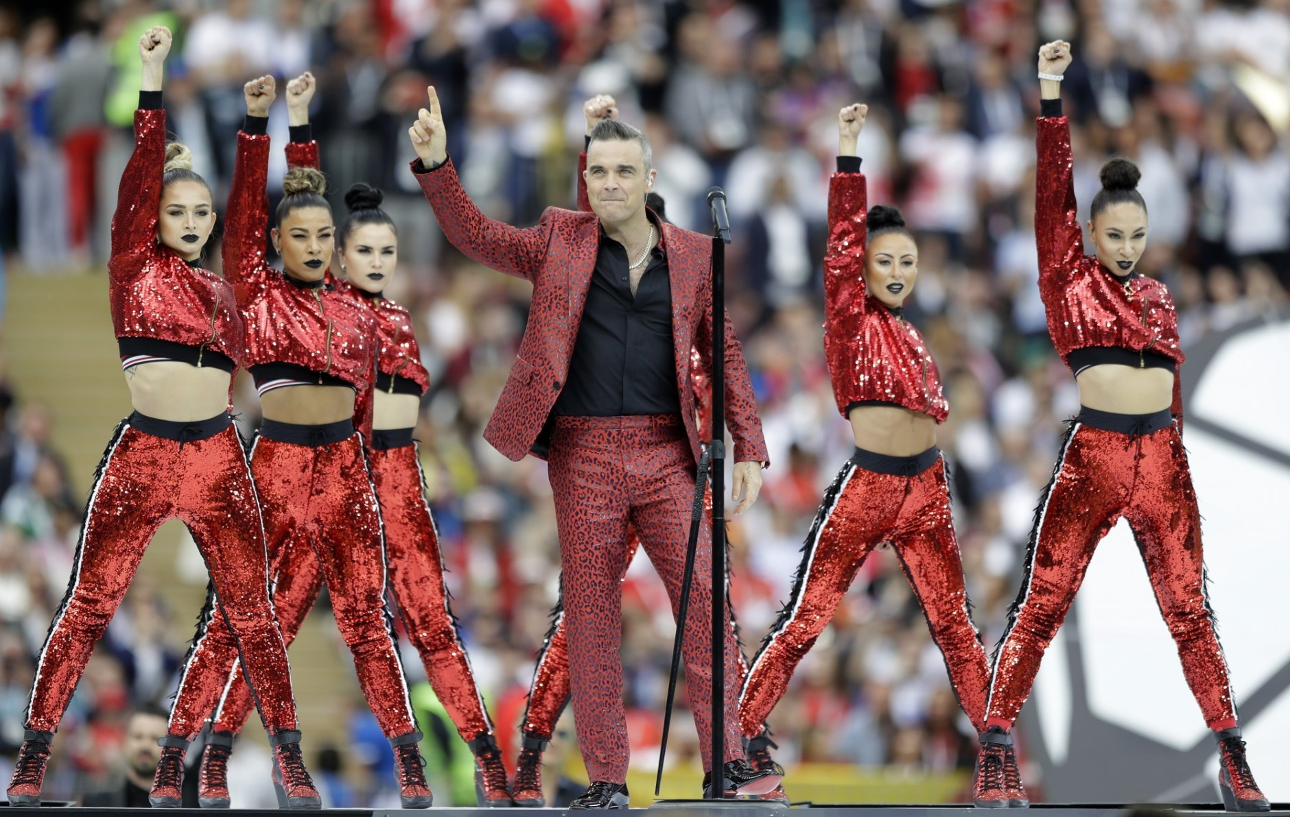 British singer Robbie Williams performs before the group A match between Russia and Saudi Arabia which opens the 2018 soccer World Cup at the Luzhniki stadium in Moscow, Russia, Thursday, June 14, 2018. (AP Photo/Matthias Schrader)