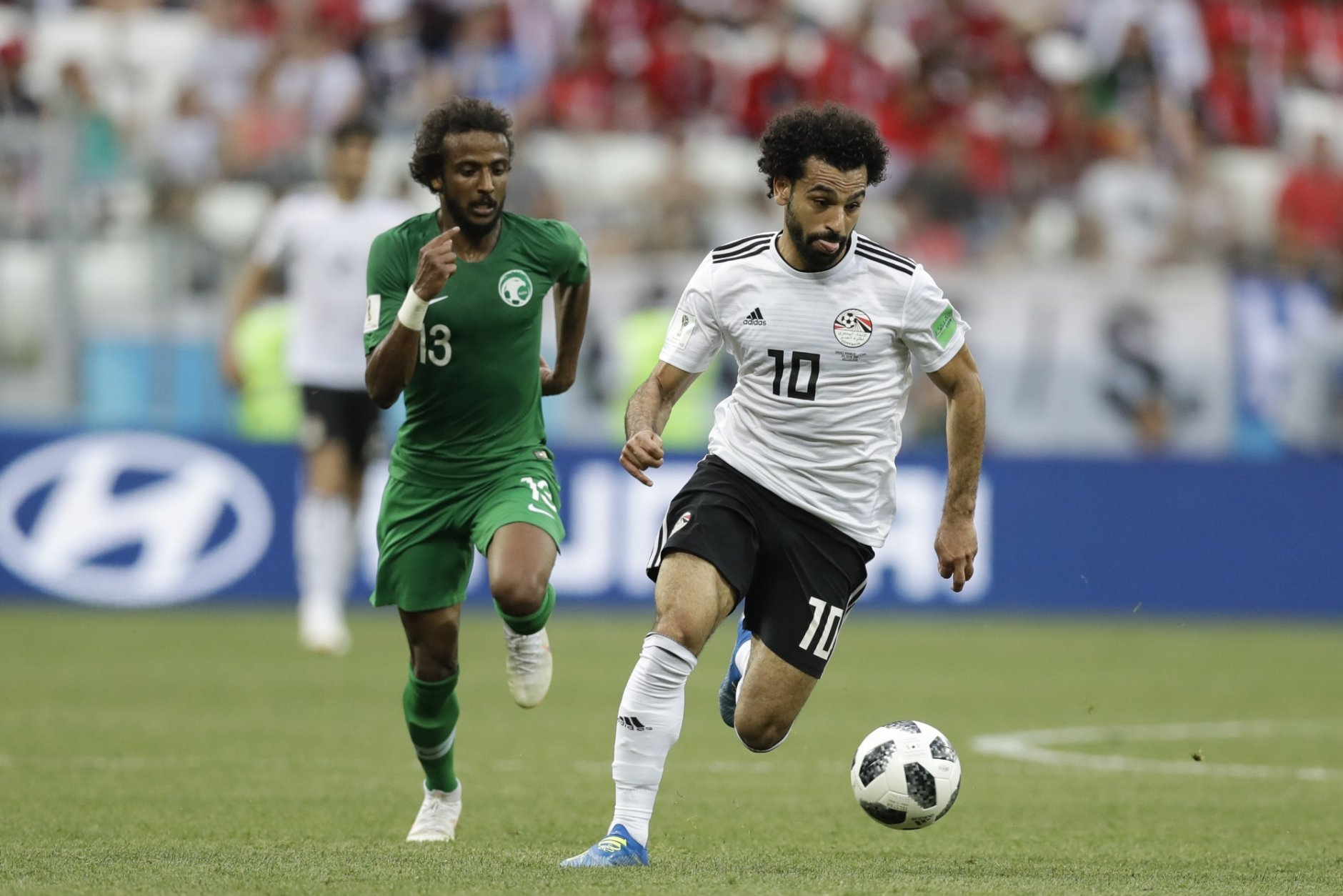 Egypt's Mohamed Salah, right challenge for the ball with Saudi Arabia's Yasir Alshahrani during the group A match between Saudi Arabia and Egypt at the 2018 soccer World Cup at the Volgograd Arena in Volgograd, Russia, Monday, June 25, 2018. (AP Photo/Andrew Medichini)