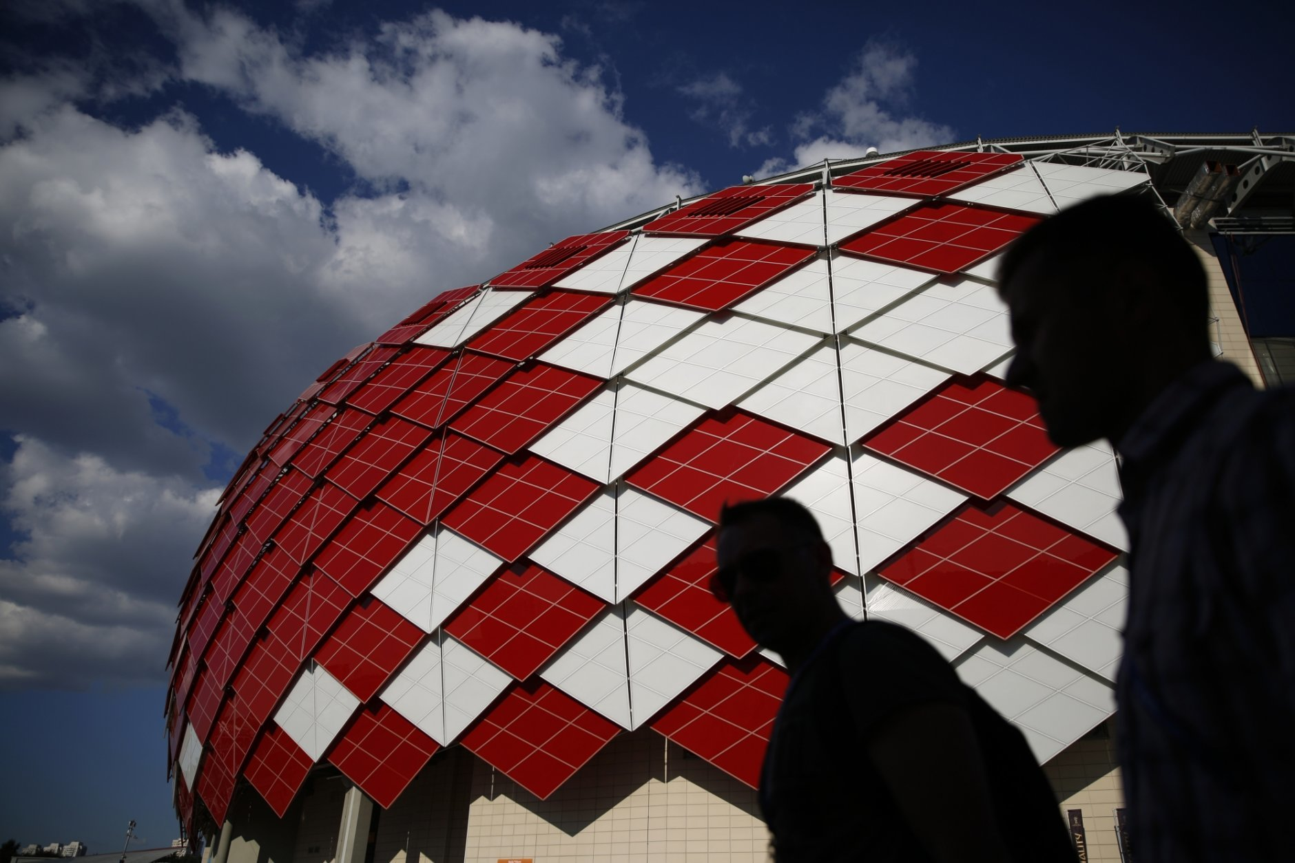 People walk outside Spartak Stadium ahead of the group E match between Serbia and Brazil, at the 2018 soccer World Cup in Moscow, Russia, Wednesday, June 27, 2018. (AP Photo/Rebecca Blackwell)
