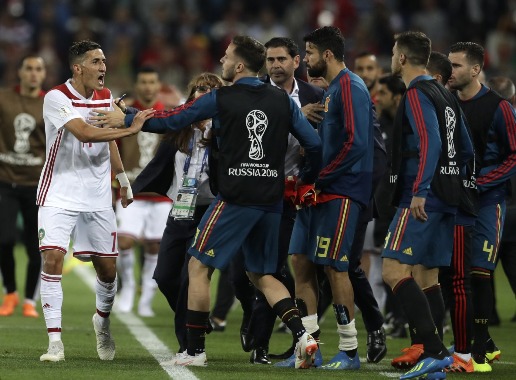 Morocco's Faycal Fajr, left, argues with Spain's players after the group B match between Spain and Morocco at the 2018 soccer World Cup at the Kaliningrad Stadium in Kaliningrad, Russia, Monday, June 25, 2018. (AP Photo/Petr David Josek)