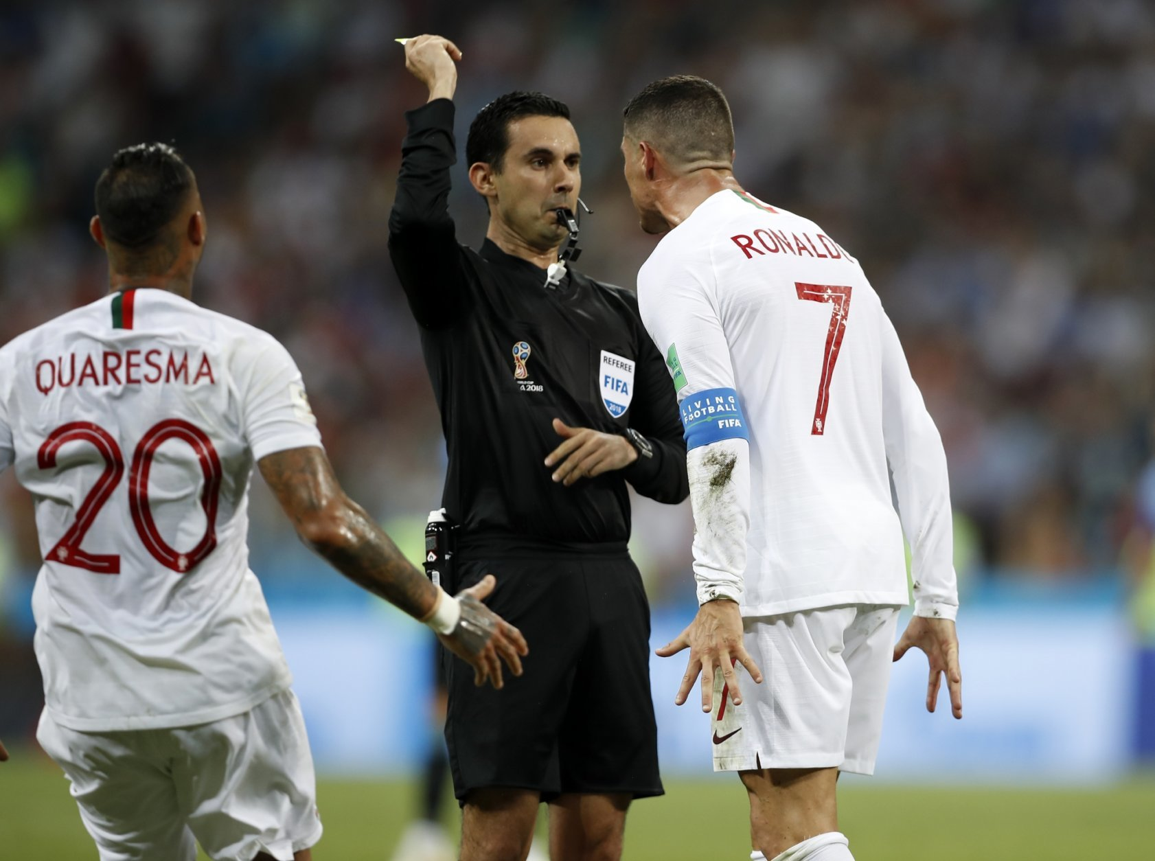Portugal's Cristiano Ronaldo reacts angry to referee Cesar Ramos during the round of 16 match between Uruguay and Portugal at the 2018 soccer World Cup at the Fisht Stadium in Sochi, Russia, Saturday, June 30, 2018. (AP Photo/Francisco Seco)