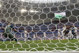 Uruguay's Luis Suarez scores his side's opening goal during the group A match between Uruguay and Russia at the 2018 soccer World Cup at the Samara Arena in Samara, Russia, Monday, June 25, 2018. (AP Photo/Rebecca Blackwell)