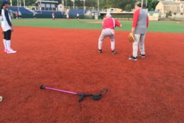 Rep. Steve Scalise, who is still using a crutch to move around, takes grounders at Republican practice the week before this year's game. (WTOP/Noah Frank)