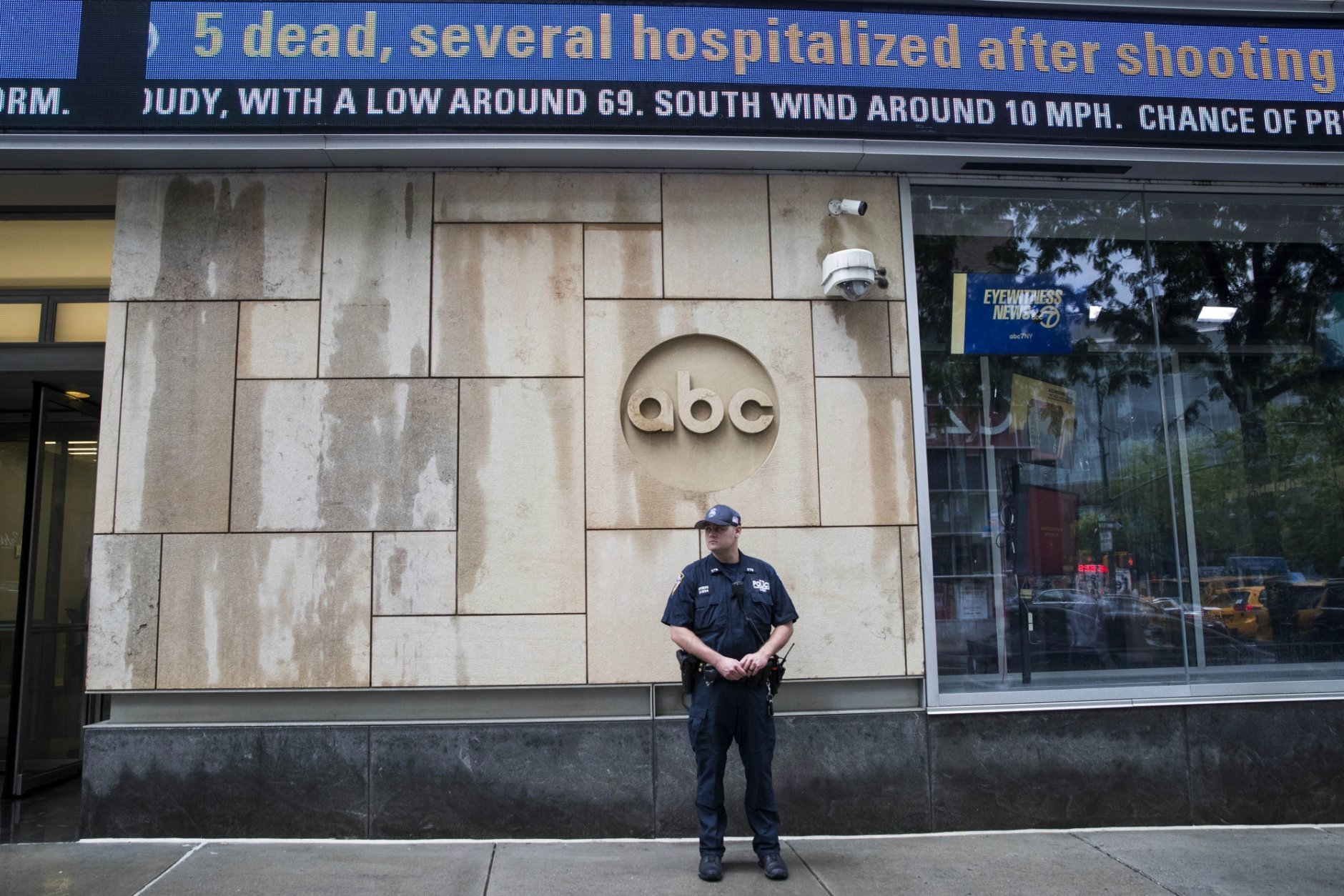 A police officer stands guard outside the ABC studio, Thursday, June 28, 2018, in New York. The New York Police Department has sent patrols to major news media organizations in response to the shooting at a newspaper in Annapolis, Maryland. (AP Photo/Mary Altaffer)